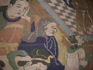 頭巾を被っている男が純陀